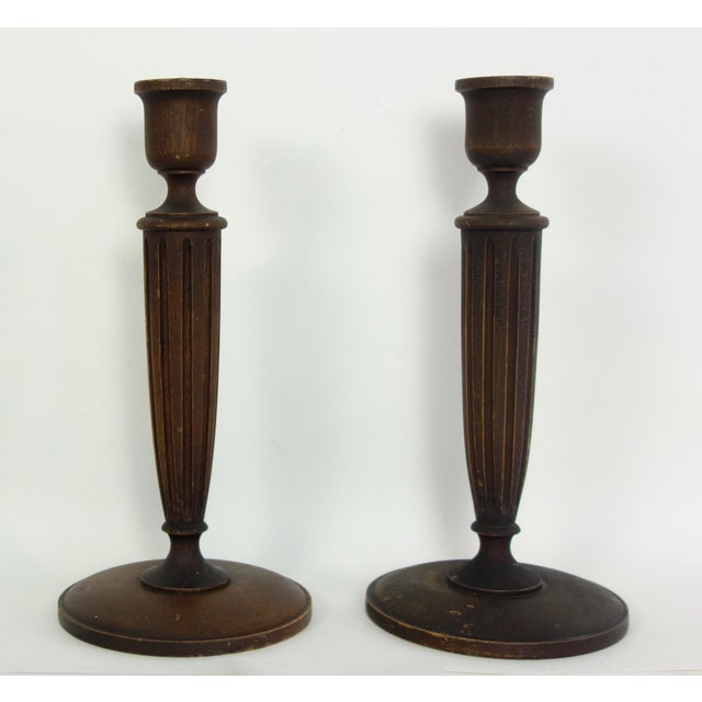 This is a beautiful pair of hand turned American walnut candlesticks with oil cloth on the undersides.