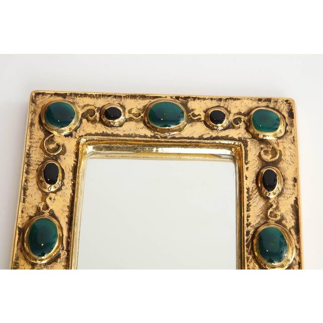 A beautiful and charming mirror designed by French artist Francois Lembo. Composed of a crackled gold glaze frame, the...