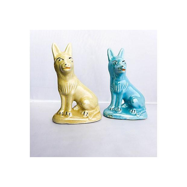 """Vintage pair of blue and yellow porcelain shepherds. Maker's mark reads """"Brazil."""" Circa 1970s."""