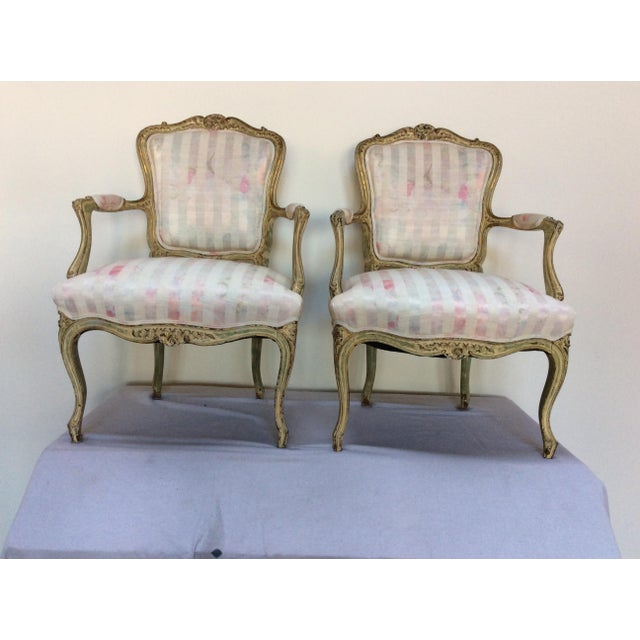 Offered is a pair of paint decorated Louis XV period fauteuils.