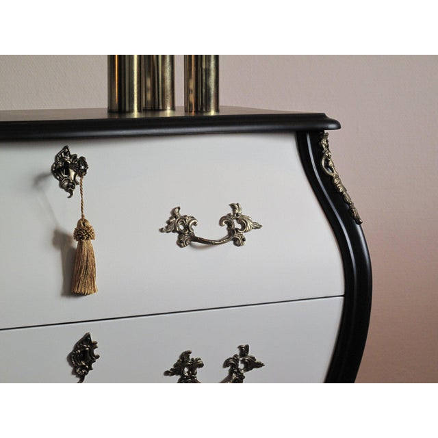 Antique Rococo chest of drawers circa 1900's newly styled in matte black and chalk white color. Original cast brass...