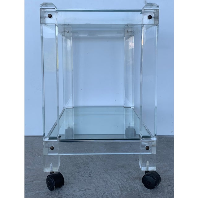 About A fine French drinks trolley or bar cart, featuring two tiers of fitted rectangular glass in a clear Lucite frame....