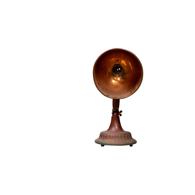 This 1940s InfraLite copper lamp has been completely rewired with braided cloth cord for the modern home. The wooden...