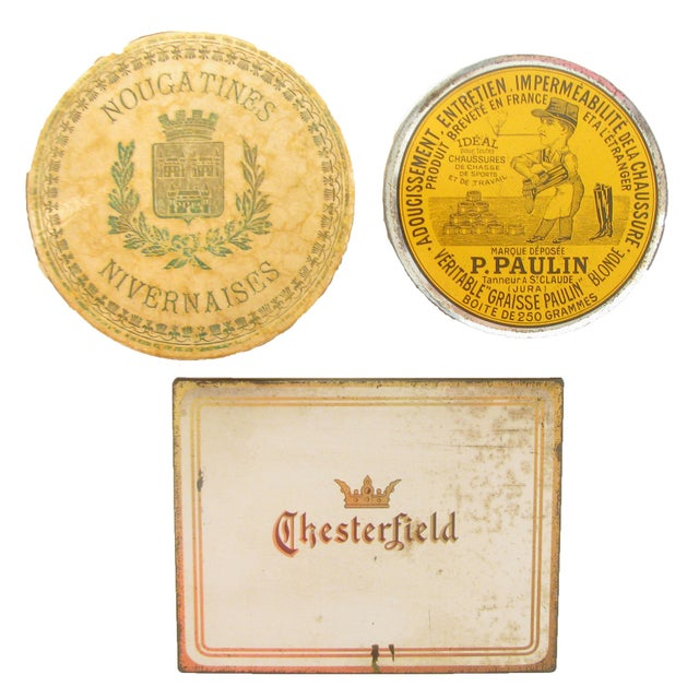 Collection of four French & American boxes and tins. The assortment consists of a Chesterfield cigarette box, a French...
