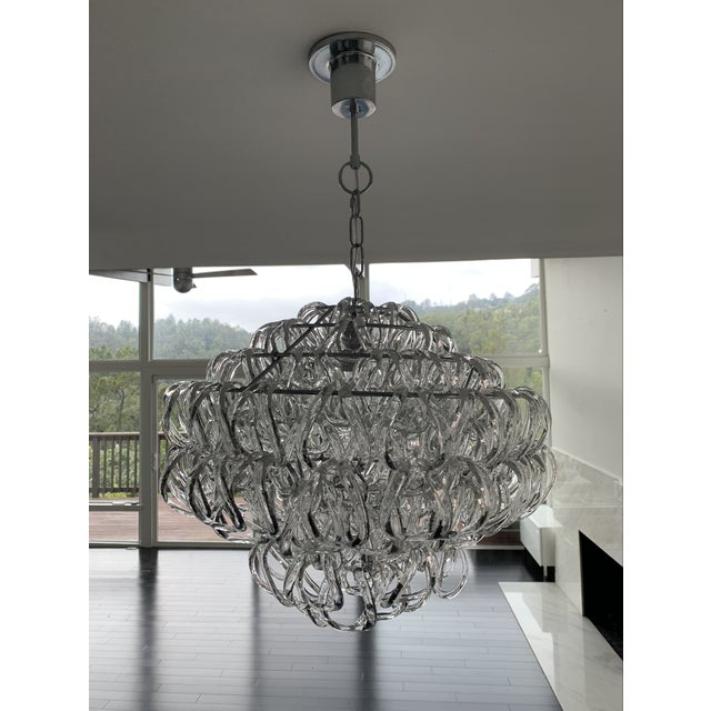 Stunning chandelier made up of 200 hand-blown Murano Glass elements interlock to create the Vistosi Giogali Pendant, a...