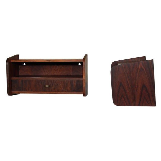 This is a set of Danish Rosewood Floating Shelves. They are in very good vintage condition. On the back wall there are...