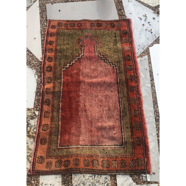 This rug is particularly unique as it is woven sideways. It is also very fine. It came from a Turkish village Cihan bey....