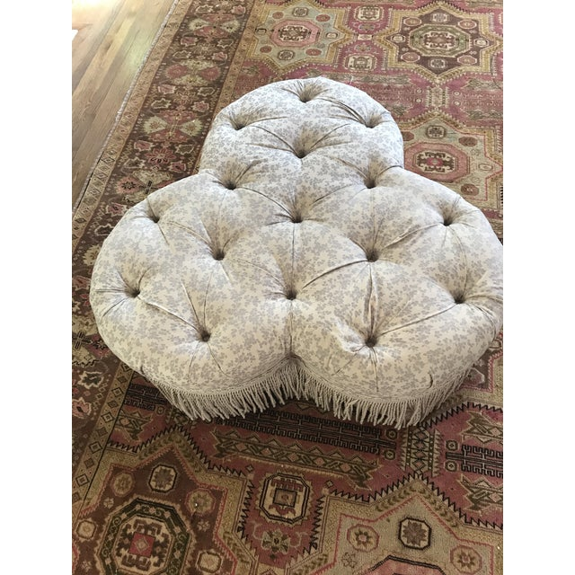 """Large vintage Ethan Allen tufted clover ottoman with 10"""" fringe. Blue muted floral pattern. Original fabric is in..."""