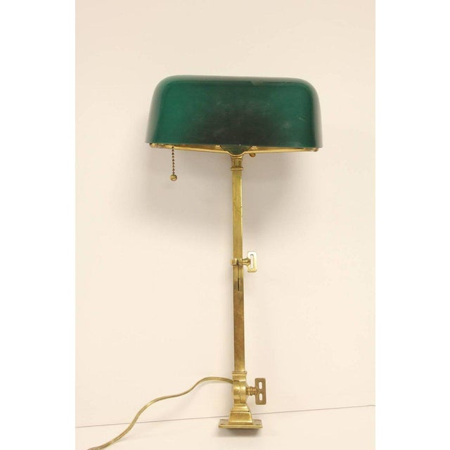 1920s American Emeralite brass adjustable desk lamp by H.G. McFaddin & Co with original glass shade. Triple-jointed.