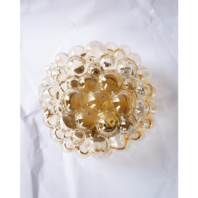 Beautiful large bubble sconce or wall light or flush mount by Helena Tynell for Glashütte Limburg, Germany, 1960s. Made of...