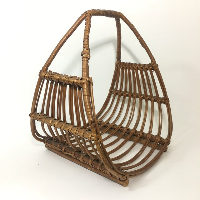Vintage Franco Albini attributed magazine rack. In great vintage condition with a small repair to one of the arms but does...
