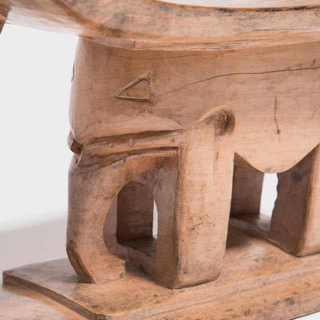 In traditional Ashanti culture of central Ghana, stools indicate power, status, and lines of succession. The flat base,...