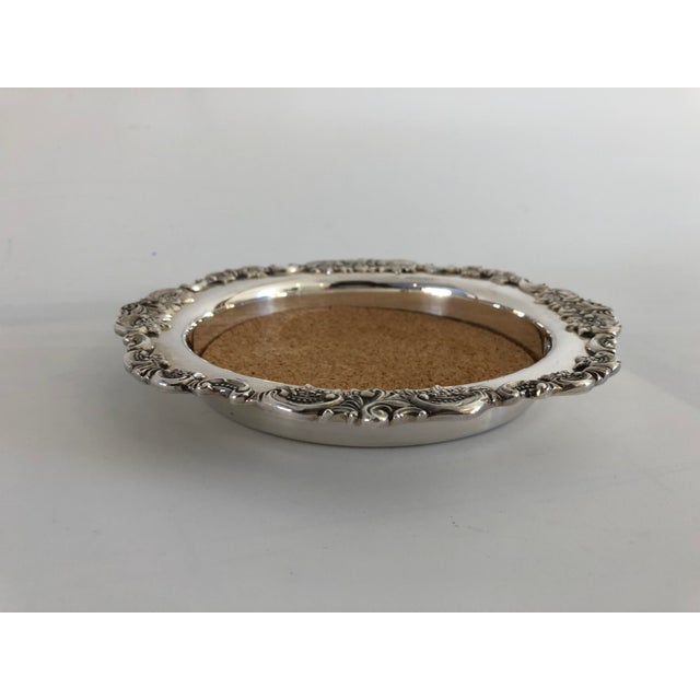 """Vintage Ornate silver plate wine coaster, 7""""D X 1"""" H, comes with cork liner ,makers mark reads """"Baroque by Wallace """" in..."""