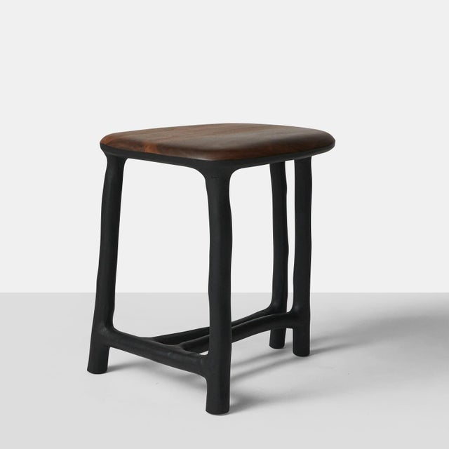 A stool or side table made with hazel branch's that have been blackened with the seat in walnut. Each piece is completely...
