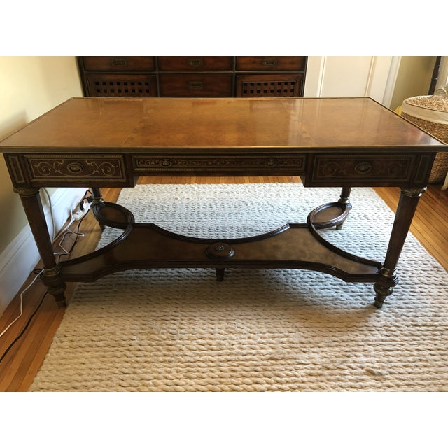 This beautiful antique reproduction oak, mahogany and brass Theodore Alexander Writing Desk is a statement piece that...