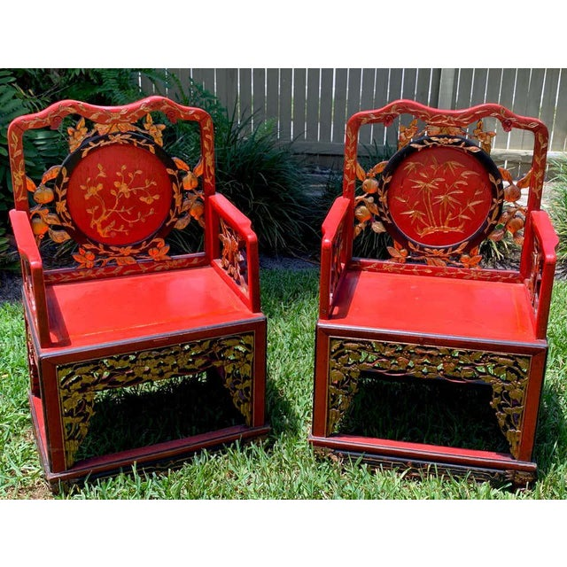 Pair of Chinese red lacquer and gilt throne chairs, Each one with carved and pierced medallion backrest, arms and seat...