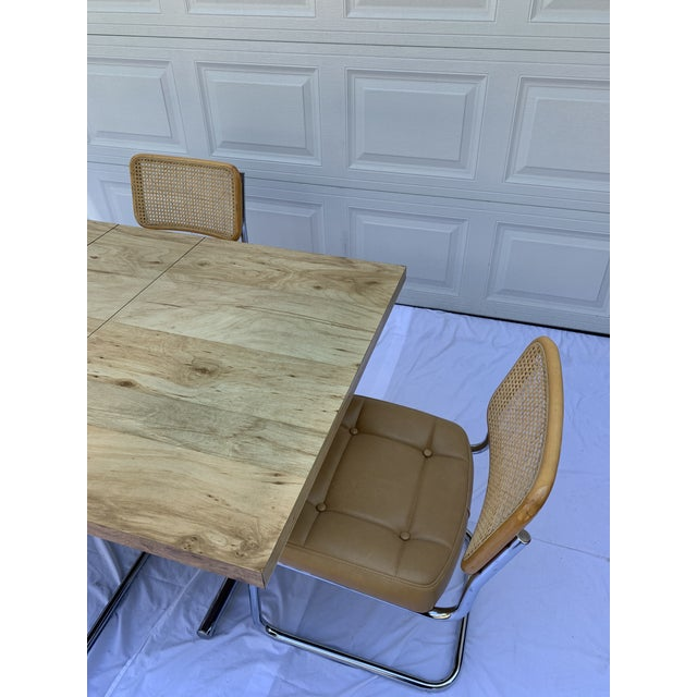 Wonderful Marcel Breuer style dining set. Wood grain laminate table with leaf and chrome base. 4 Cesca cantilever chrome...