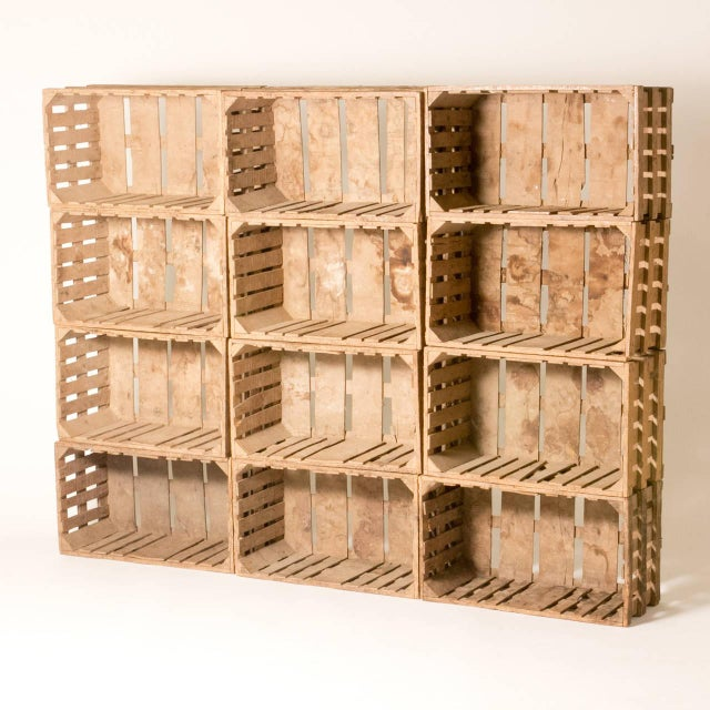 Bookcase made out of twelve wooden crates from early 20th century France. Can be purchased in multiples of four.