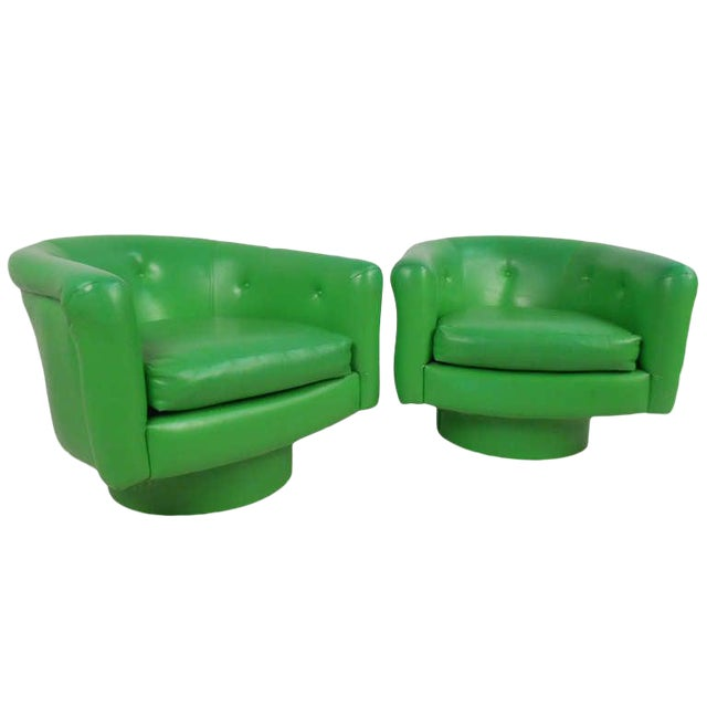 Pair of Vintage Lounge Chairs With Swivel Base For Sale