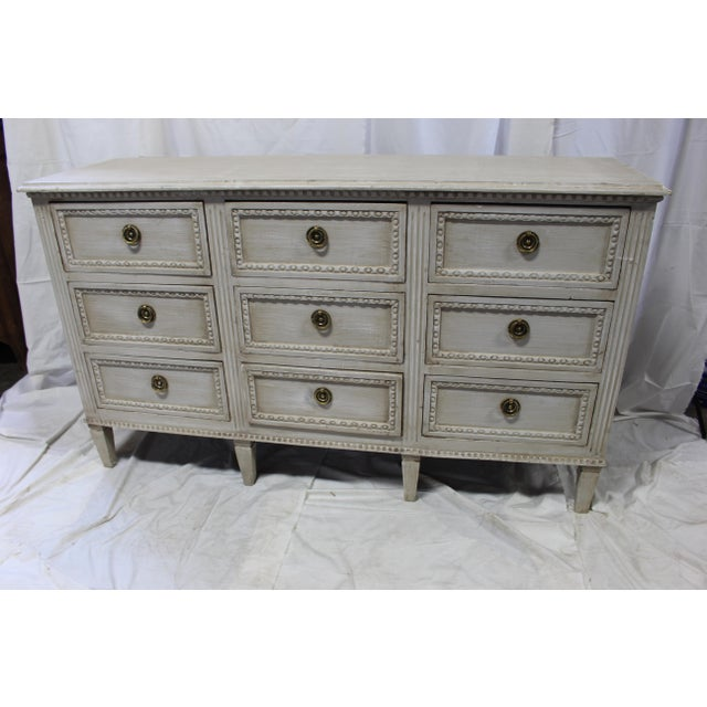 Gorgeous Gustavian Dresser imported from France. Hand carved from solid Oak wood with intricate details around each of the...