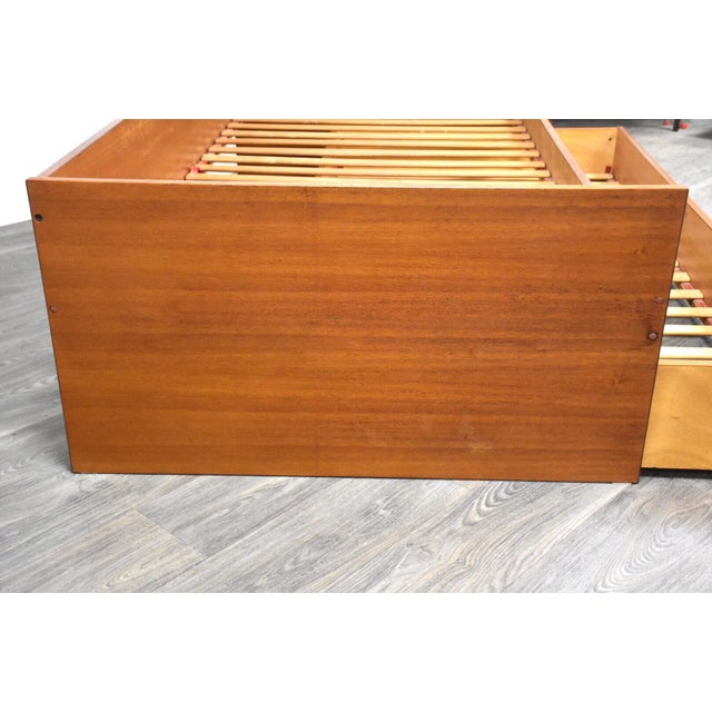 "A mid century modern teak twin trundle bed. Made in Denmark. Bottom mattress needs to be 6.75"" thick or less to clear."