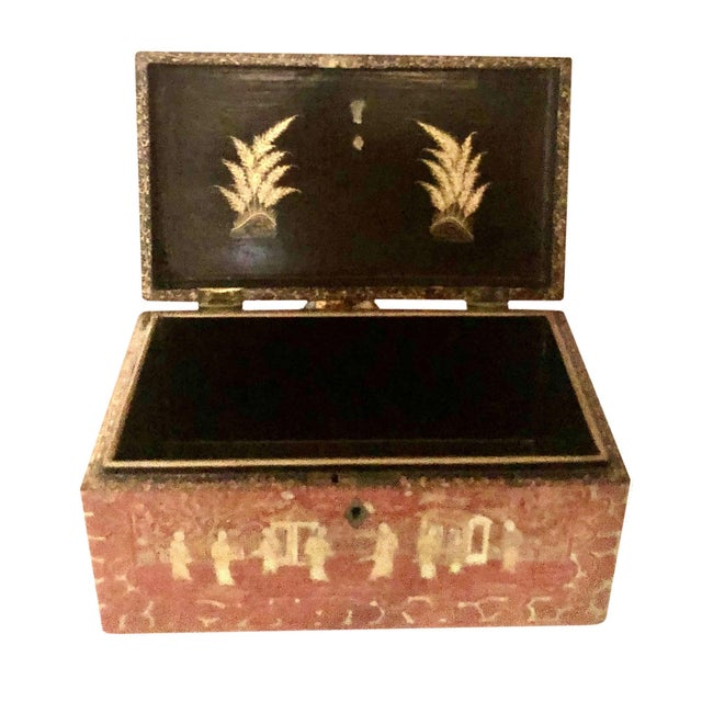 A very high quality rose colored Chinese export box with black and gold interior.