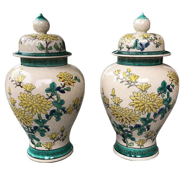 Pair of Famille verte 20th Century Chinese Ginger Jars. Yellow Magnolias and mums hand-painted on a crackled cream...