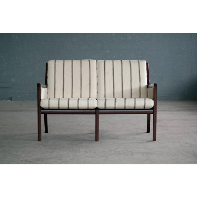 Classic and very elegant settee by Ole Wanscher designed in the 1950s and produced by P. Jeppesen Møbelfabrik likely...