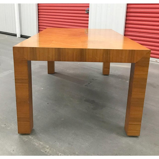 Handsome dining table in burl wood book matched veneer, circa 1970s. By Milo Baughman for Thayer Coggin. Comes with one...
