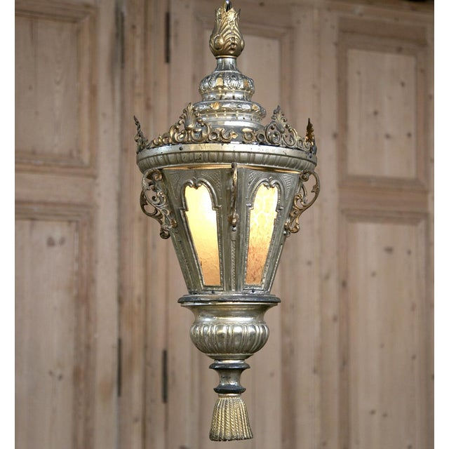19th Century Venetian Silverplated Brass Lantern Chandelier was originally designed for a large pillar candle. We have now...