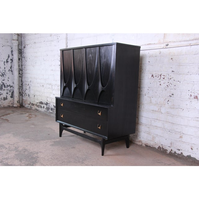 Offering a stunning mid-century modern gentleman's chest or highboy dresser by Broyhill Brasilia. The chest features the...