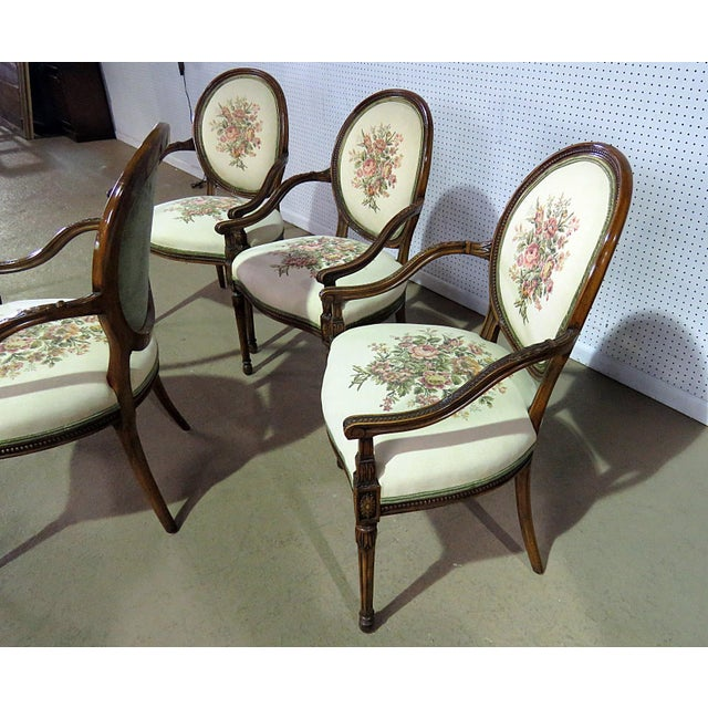Set of 4 Adams style carved arm chairs with tapestry upholstery by Flair Decorators.
