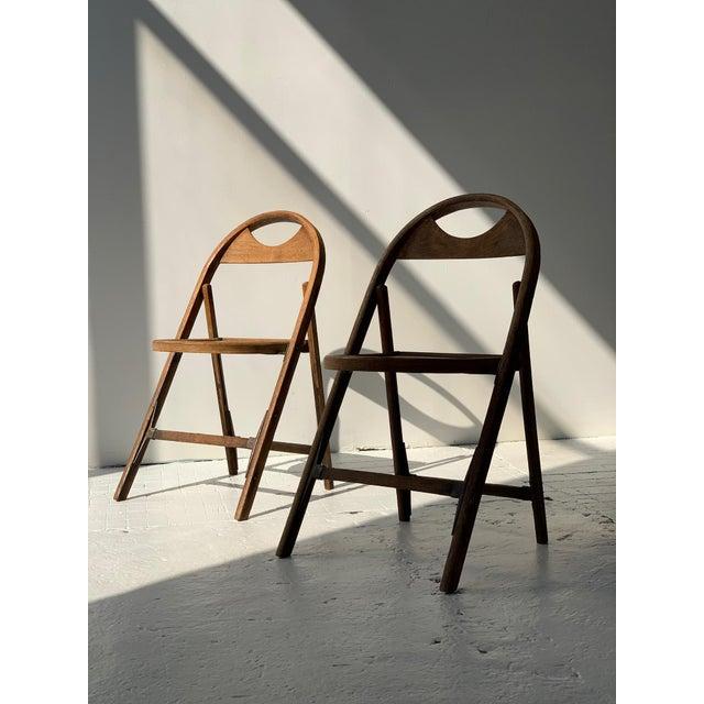 Bauhaus Bent Wood Folding Chairs, Circa 1930s. Steam-bent oak frame with riveted construction. Beautiful weathered patina....