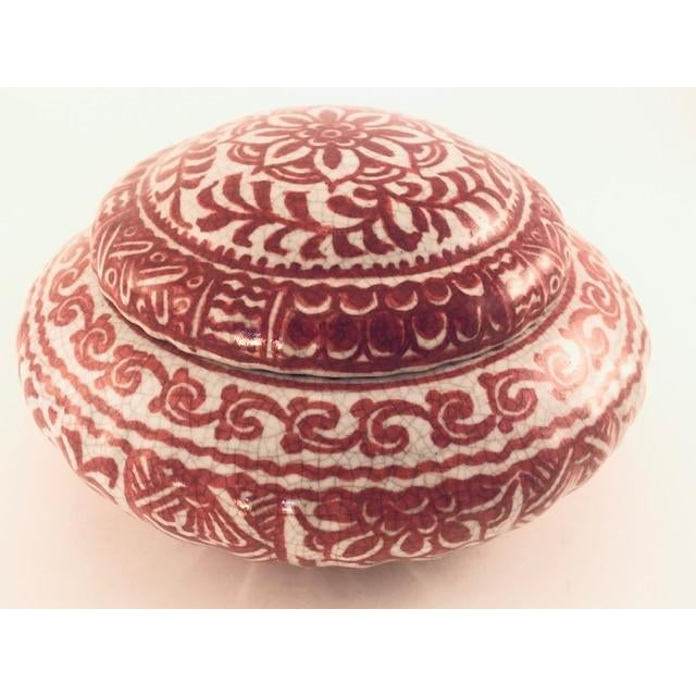Vintage Dutch Delft bowl with lid, decorated in red on a craquele ground from the renowned Porcelyne Fles pottery, located...