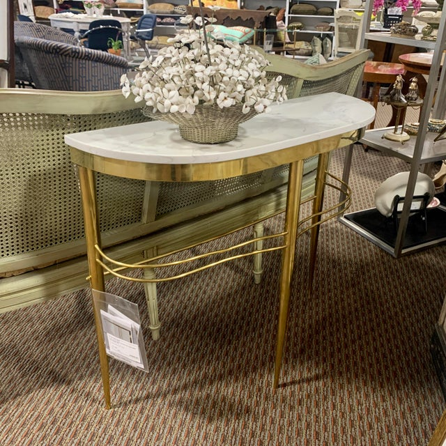 Console found in Italy features a stream lined brass base with three tapered legs and slender supports with a white marble...