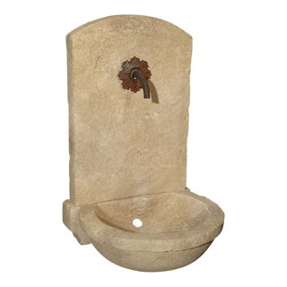 Small Carved Limestone Wall Fountain With Circular Basin For Sale