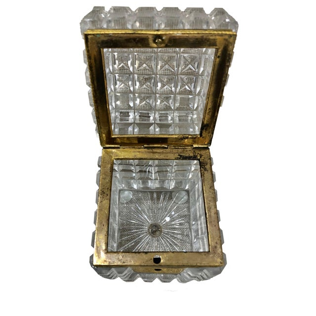 French Baccarat crystal box in the Neo Classical style. A fabulous very deeply cut box with beautiful gilt bronze...