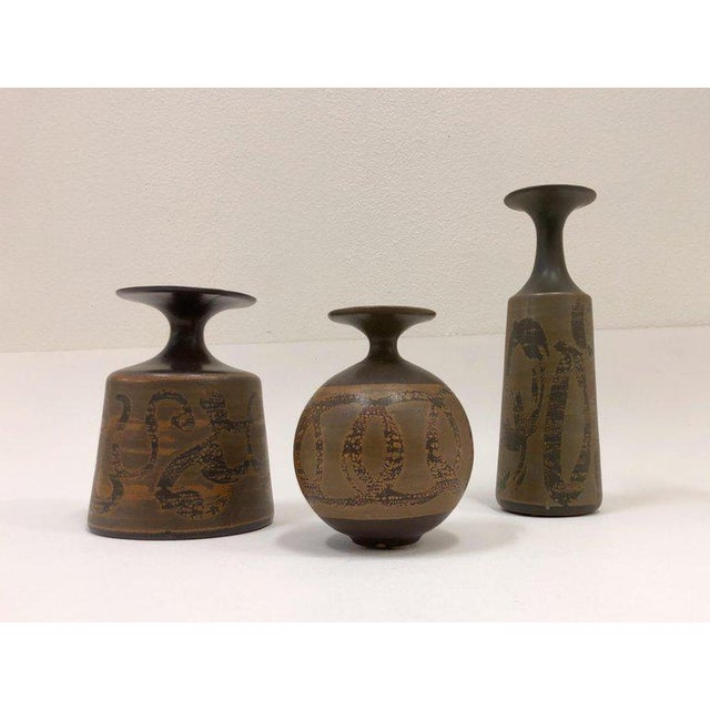 A set of three large ceramic vases designed by Robert Maxwell for Designs West of California in the 1970s. Measures:...