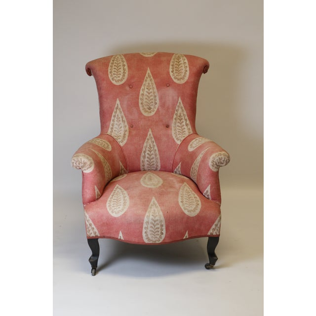 Beautiful 19th century French arm chair with scroll back and arms. The frame is fully upholstered in a linen printed...