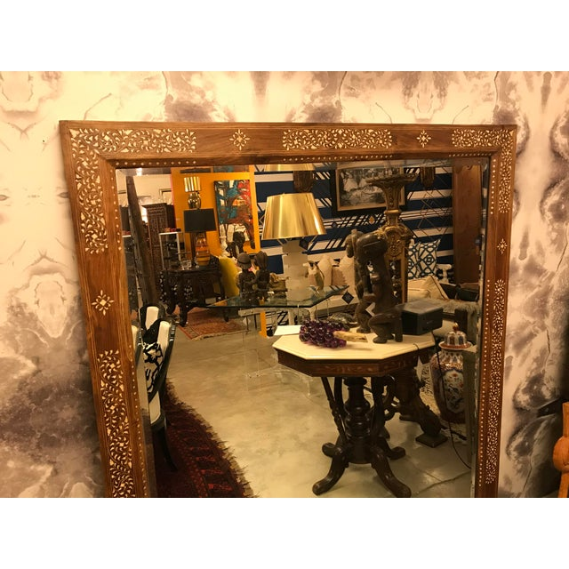 Very beautiful teak mirror with bone inlay. This mirror would show well in any decor. All handmade.