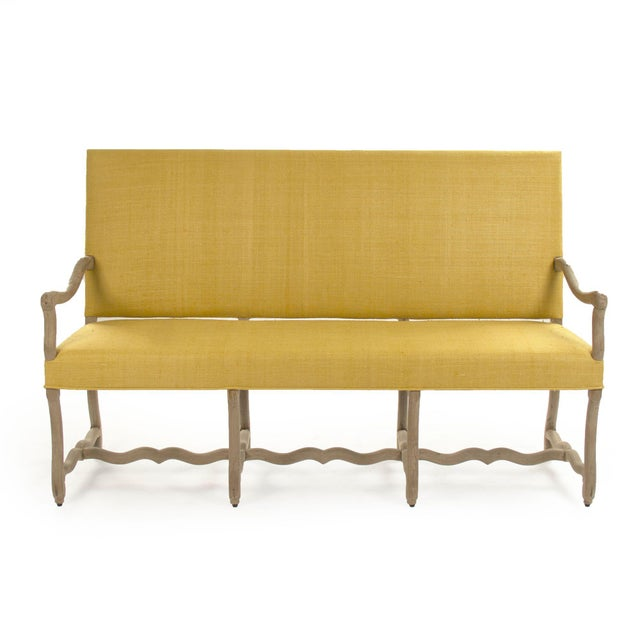 Bench upholstered in mustard yellow raw silk with curved vine like legs in dry natural finish.