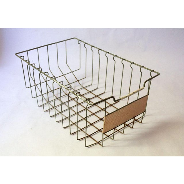 A vintage wire basket with loads of industrial charm. Blank copper label with grid texture. Perfect for paper clutter and...