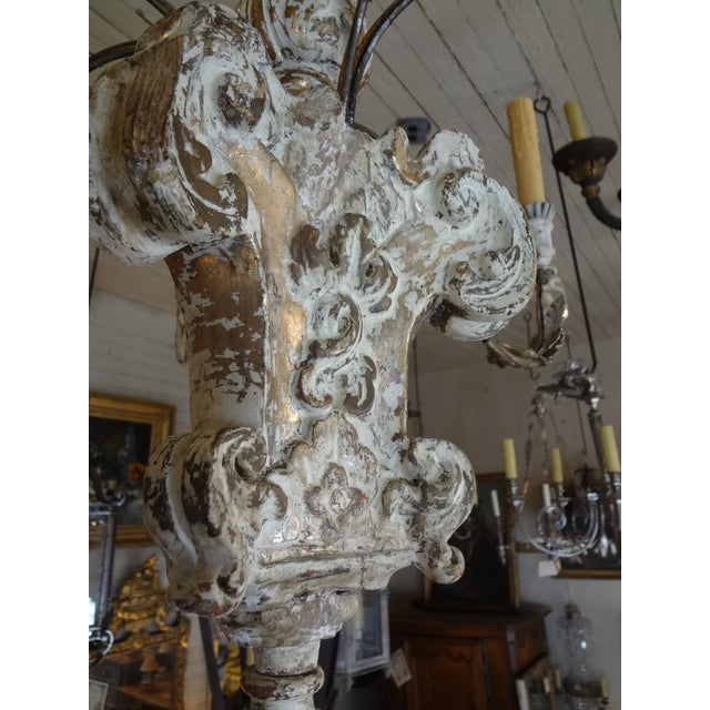 This a gorgeous Italian chandelier. Light , airy and gives a lot of light. The stem is early 19th century but the iron...