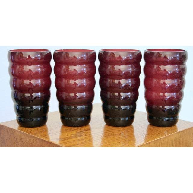 Gorgeous deep plum, handblown glass set of 4 Postmodern vases. These are incredibly striking on display and have such...