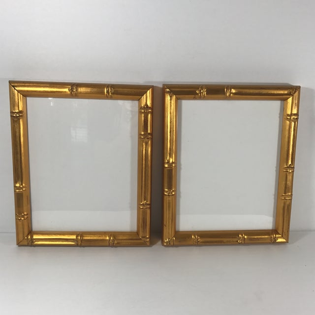Faux bamboo frames in gold gilt. Each frame holds an 8 x 10 picture, or can be matted to hold either a 5 x 7 or 4 x 6....