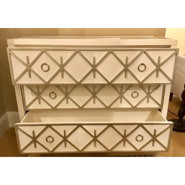 Chic Modern Lattice Greet You white three door chest by: Caracole, soft white frame with champagne lattice detail and...