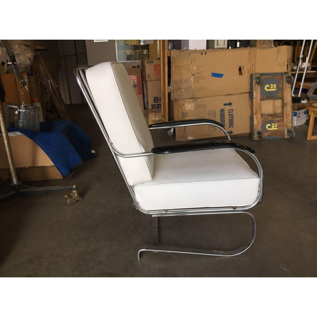 """Original """"Springer Chair"""" Rocking chair constructed with a chrome plated steel frame designed by KEM Weber by Loyd with..."""