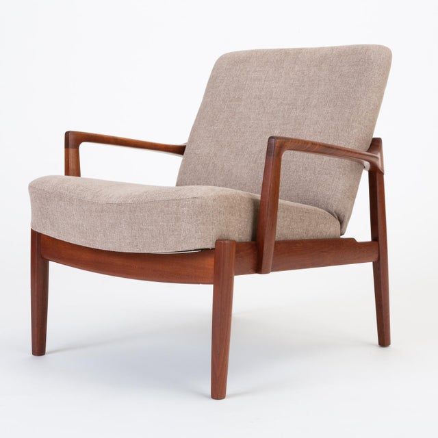 A low, Danish lounge chair by husband-and-wife design team Tove and Edvard Kindt-Larsen for France & Son. This example...