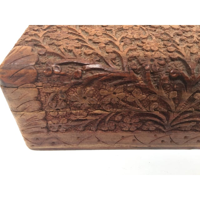 Hand-carved Anglo Raj early 20th century carved wood box richly decorated overall with arabesques and floral carving....