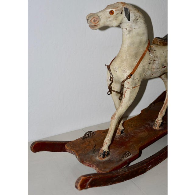 19th Century American Folk Art Rocking Horse Fantastic American Folk Art hand carved rocking horse with ample remains of...